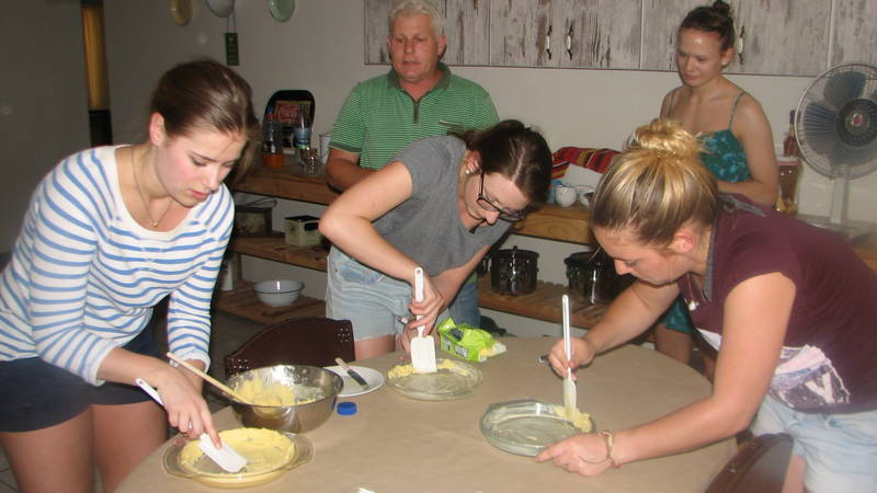 Volunteer groups making a SA dessert