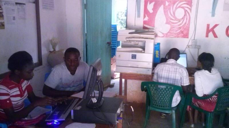 Students attending a computer class