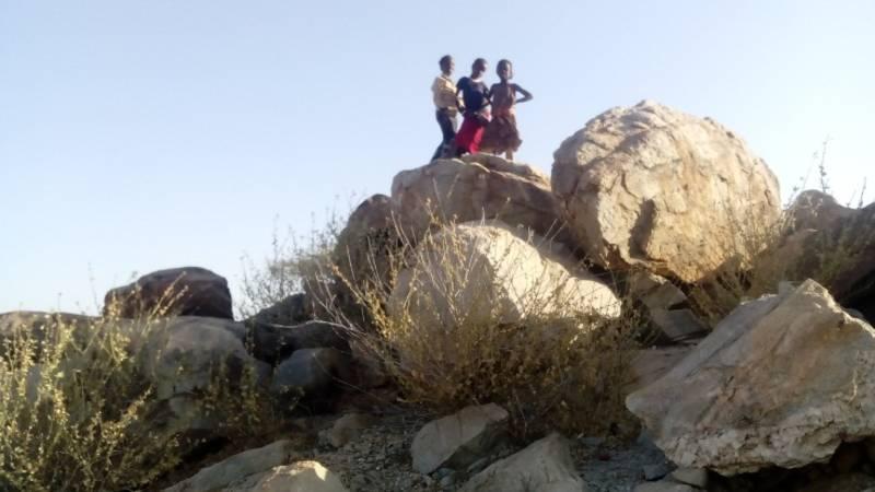 children on rocks