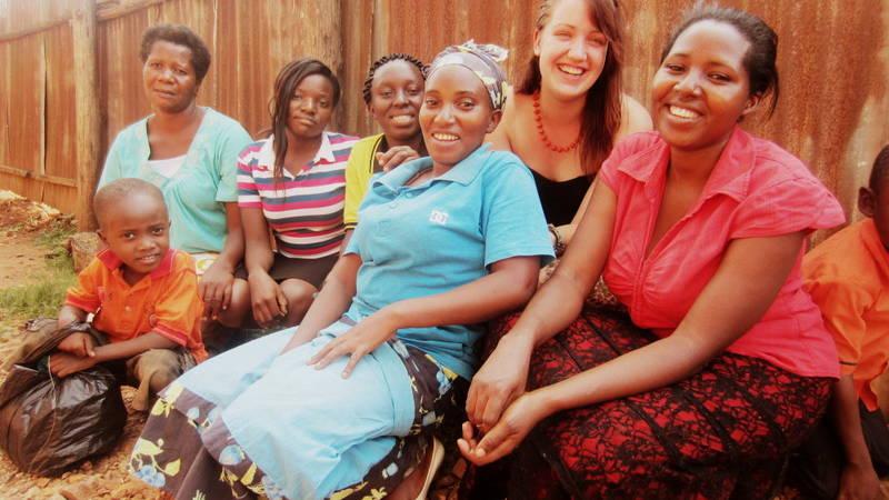 A volunteer interacting with women.