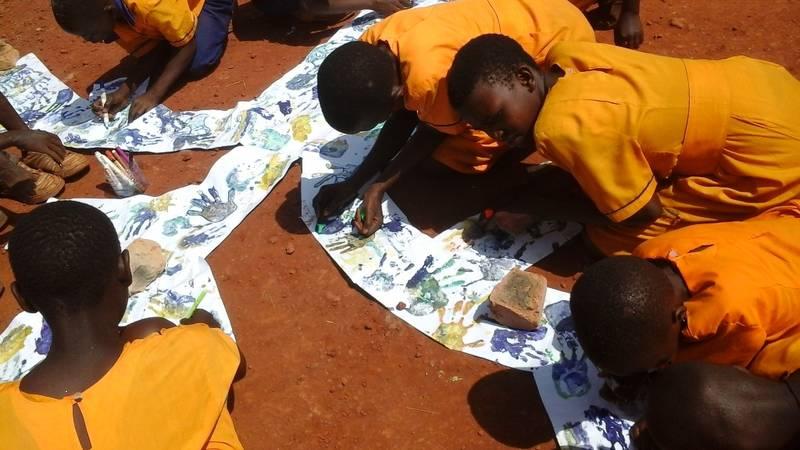 kids doing an outside art project