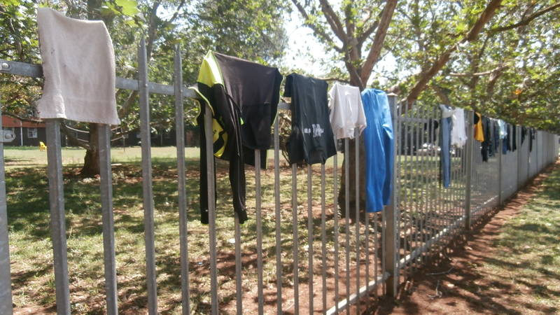 Street children letting their new clothes dry