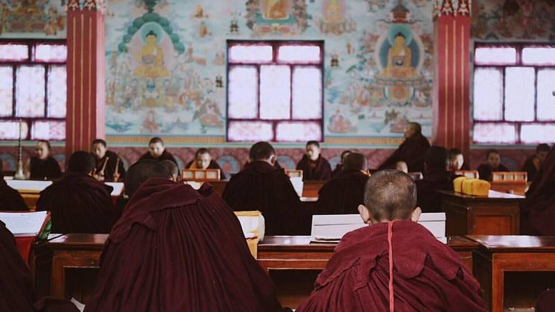 Teaching Buddhist Monks in Monastery