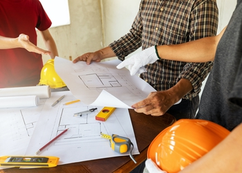bigstock-Architect-Discuss-With-Enginee-308313289.jpg
