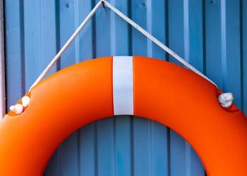 bigstock-Orange-Lifebuoy-Hanging-On-The-370642075.jpg