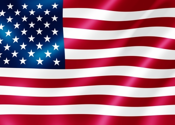 bigstock-USA-flag-blowing-in-the-wind-i-26282609.jpg