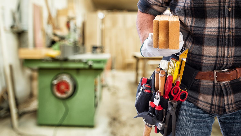 bigstock-Carpenter-At-Work-On-Wooden-Bo-344966248.jpg