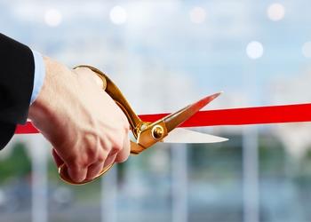 bigstock-Businessman-cutting-red-ribbon-130154564.jpg