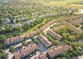 bigstock-Top-View-Green-Subdivision-Res-253645036 (1).jpg