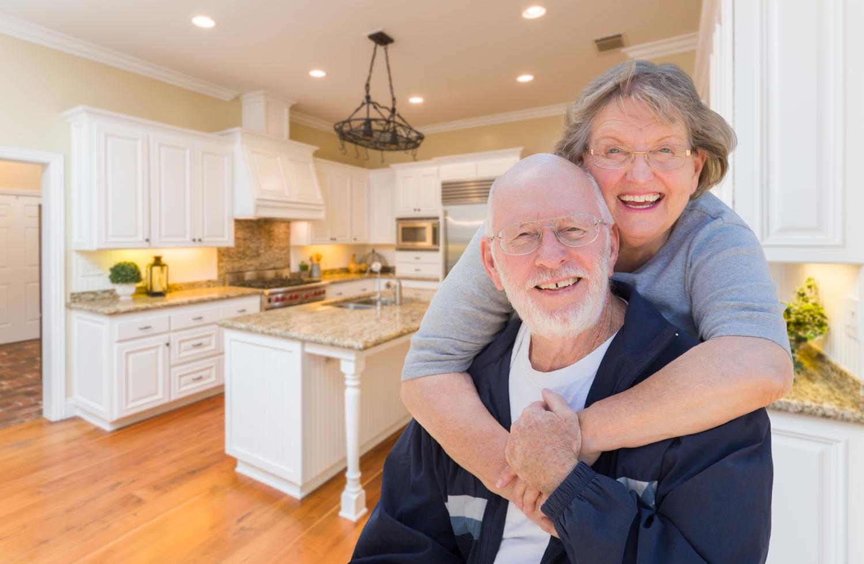 bigstock-Happy-Loving-Senior-Couple-Hug-142143713.jpg