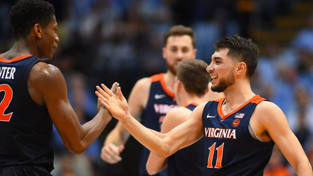 Virginia Cavaliers NCAA Basketball: No. 4 Virginia survives No. 8 North Carolina's upset bid.  Virginia was coming off a lo...