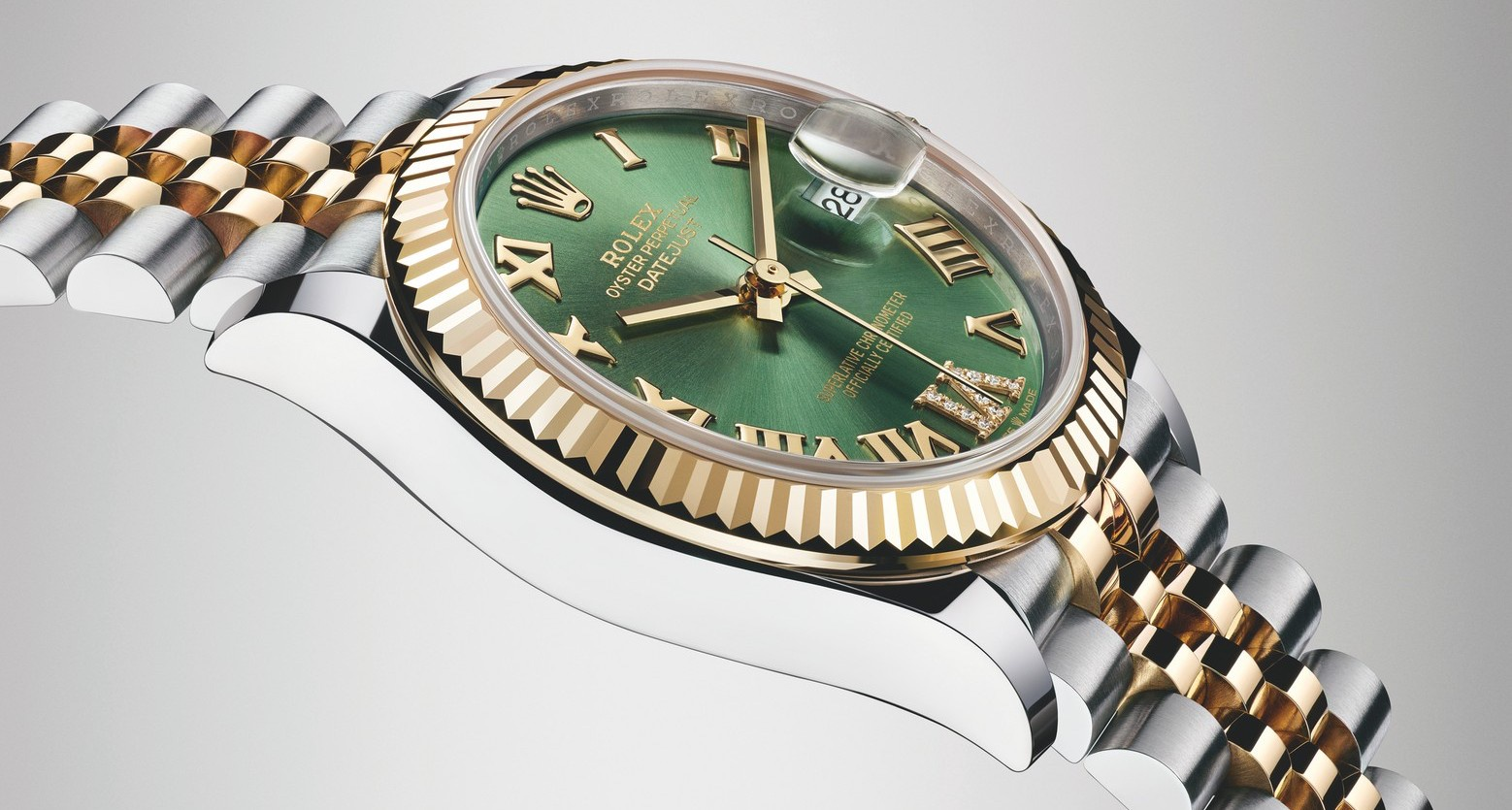 Rolex Oytster Perpetual Datejust 31, Greed Dial and Gold.