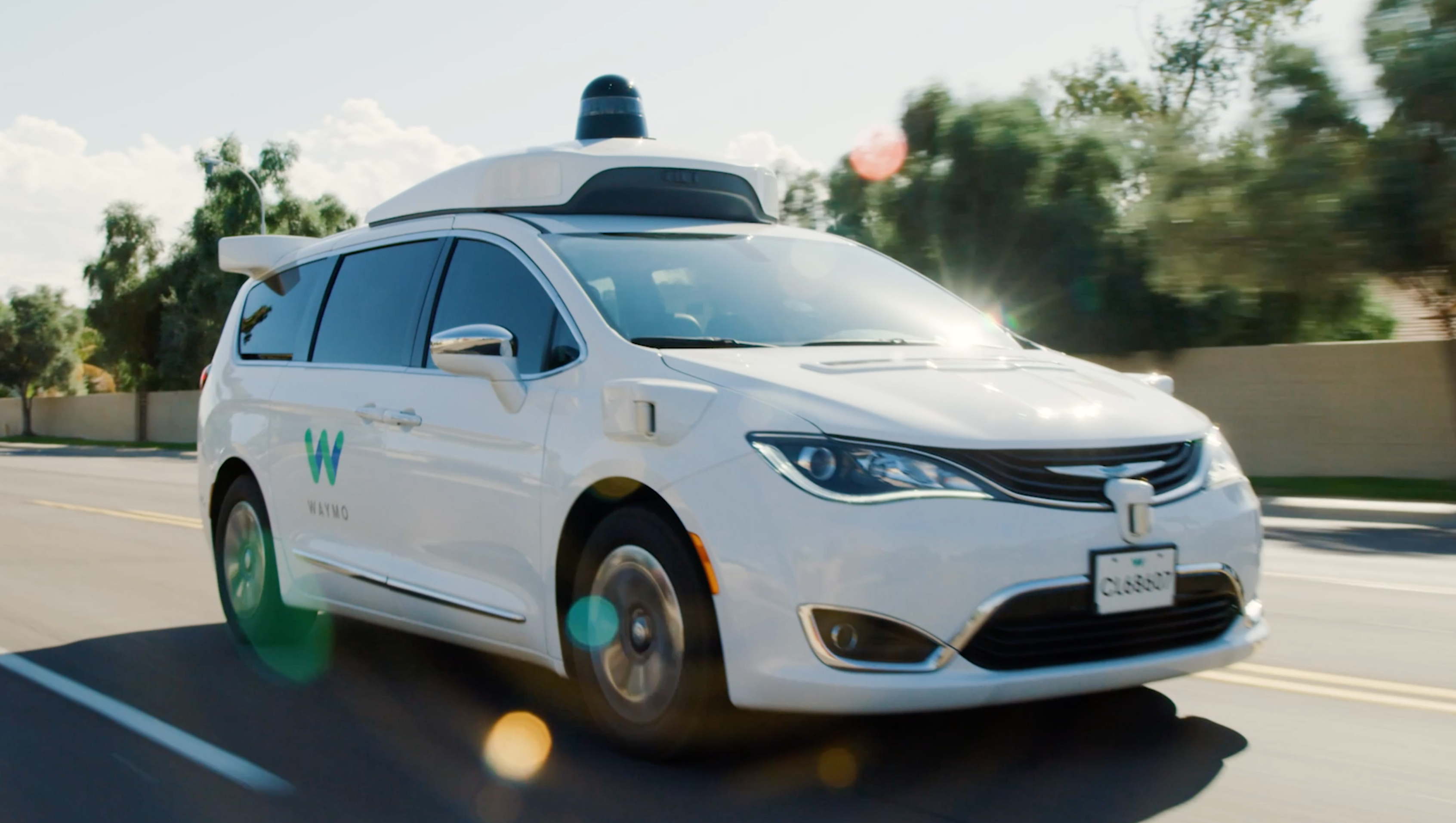 Waymo's autonomously driven Chrysler Pacifica Hybrid minivan with riders only
