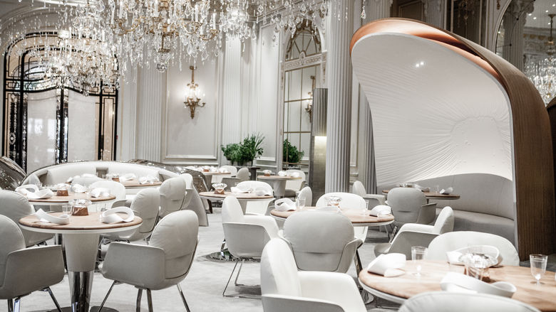 the atmosphere is a french bourgeoisie style with a hint of modern minimalist design chandeliers and white chairs make the ambience here