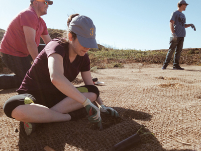 Megan King and Nathaniel Downs from 3Degrees dig in for a community planting project. Their 3DGives! program operates year-round to keep community connections on track.