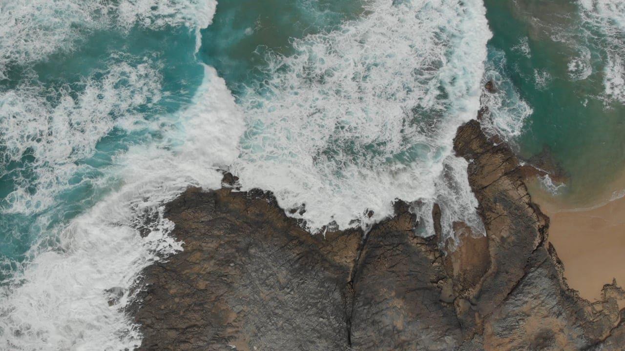 Decorative image of waves on rocky landscape