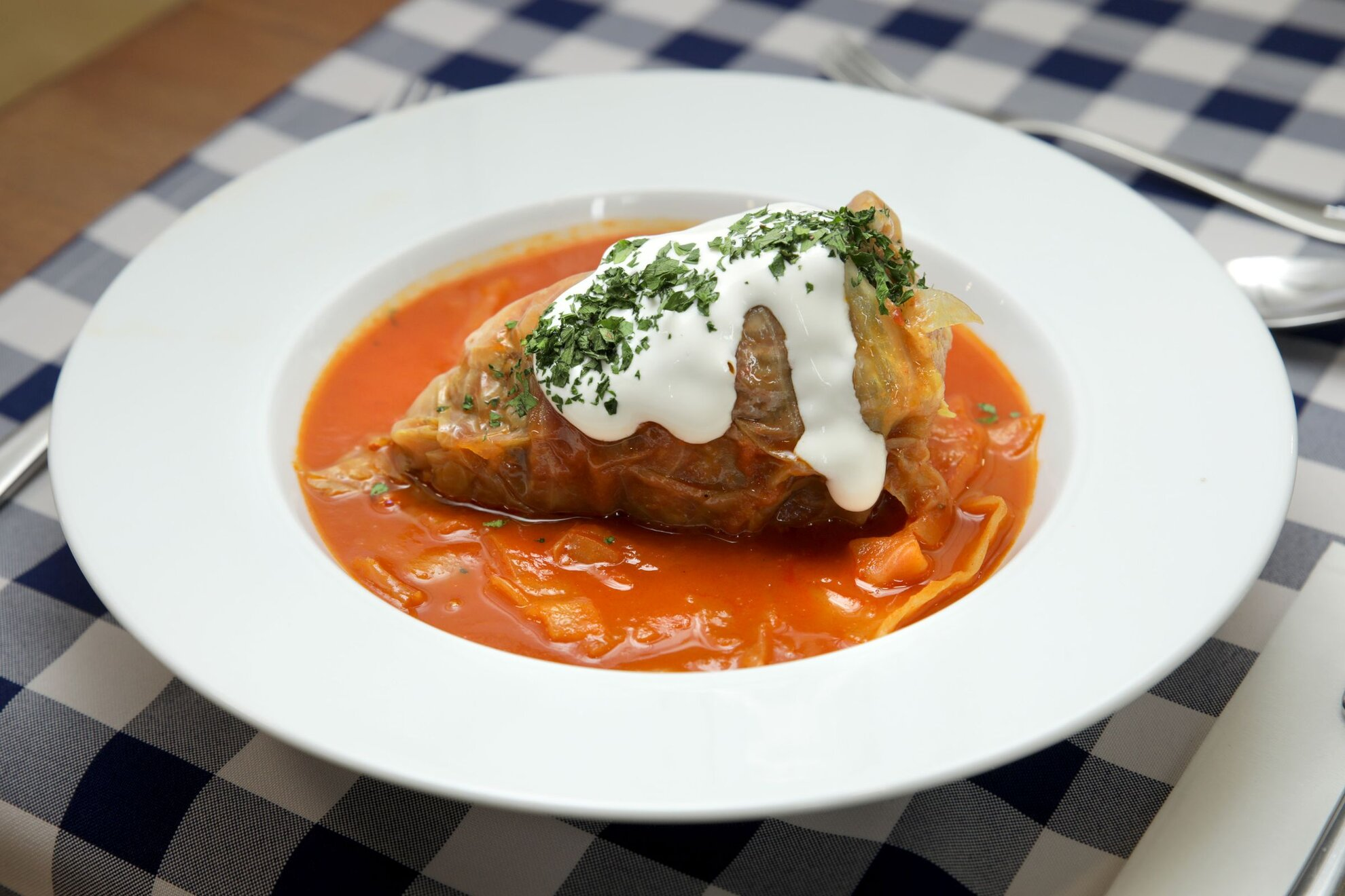 Try your hand at cooking traditional Hungarian stuffed cabbage with this authentic recipe