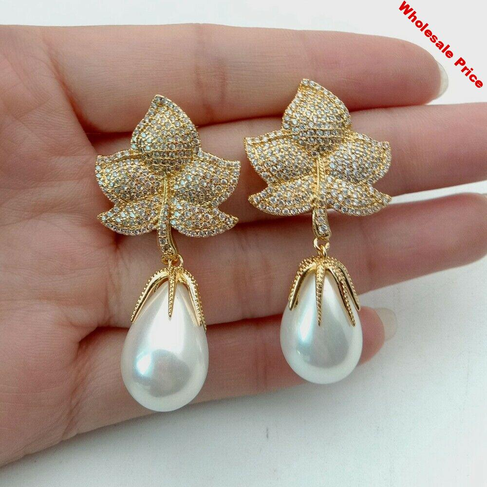 0acec977-0acec977-1-7-white-sea-shell-pearl-golden-plated-cz-micro-pave-drop-earrings..jpg