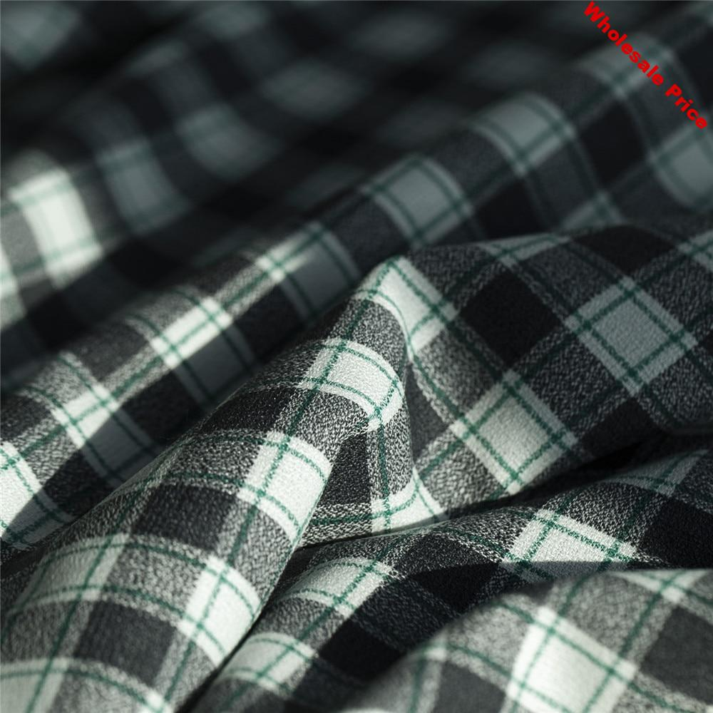Yarn-dyed black-white and green check/plaid worsted wool blends polyester fabric