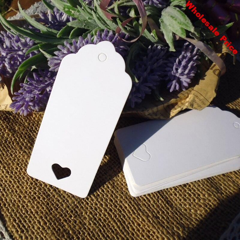 6ce5905a-6ce5905a-new-500pcs-string-included-white-paper-gift-tag-with-hollowed-heart-heart-style-paper-hang-tag..jpg