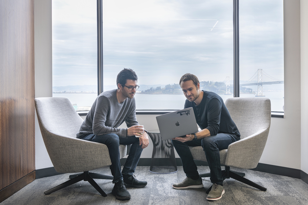cofounders-working-with-bay-bridge-view