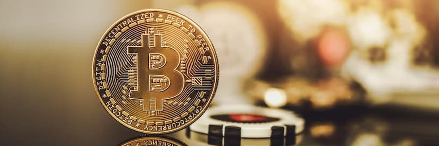 bitcoin with casino chips in the background for gambling