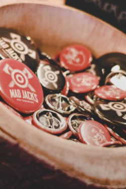Photograph of Mad Jacks pin badges