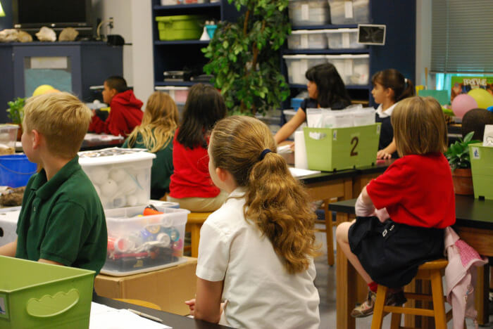 Students in a science classroom lab