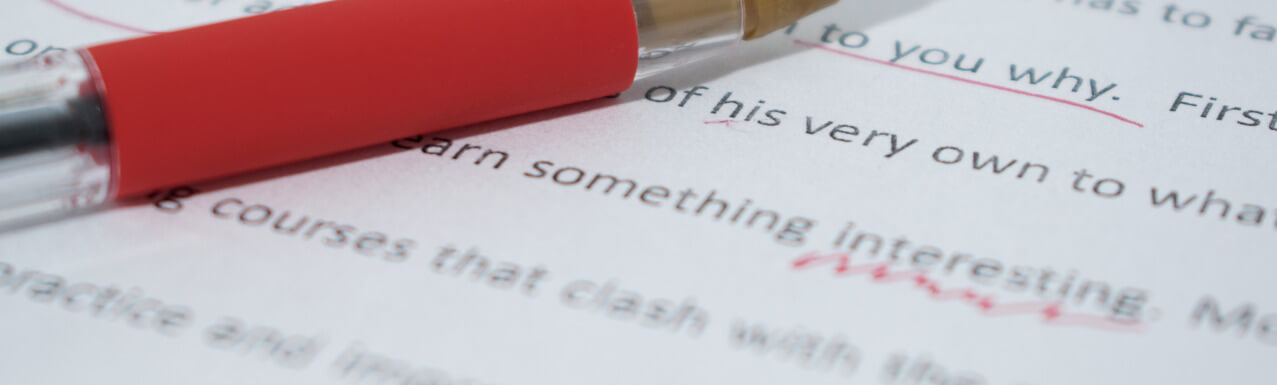 red pen on an essay with some corrections