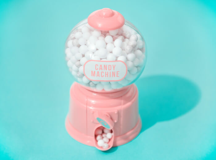 pink candy machine on a blue background