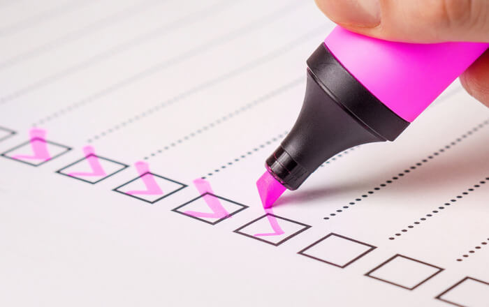 Checklist with a pink highlighter checking the boxes