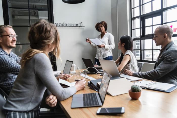 teacher leading a meeting in a brainstorm