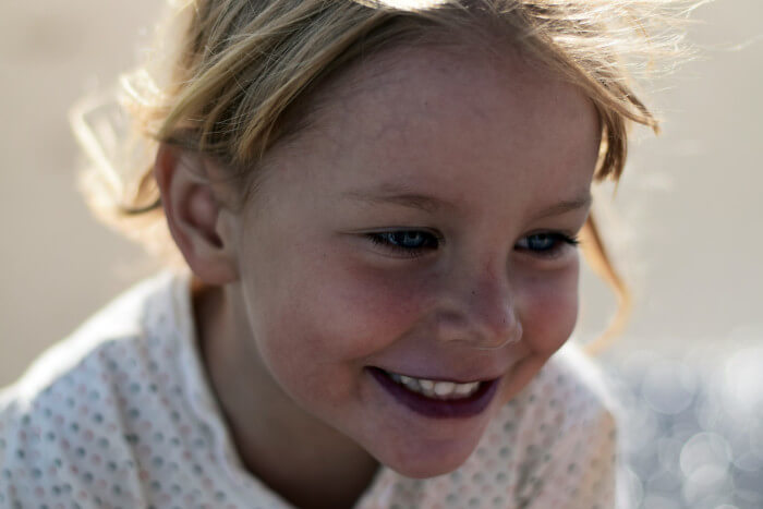 blond child smiling