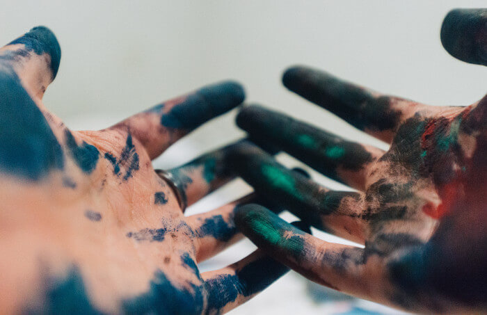 hands with paint on it