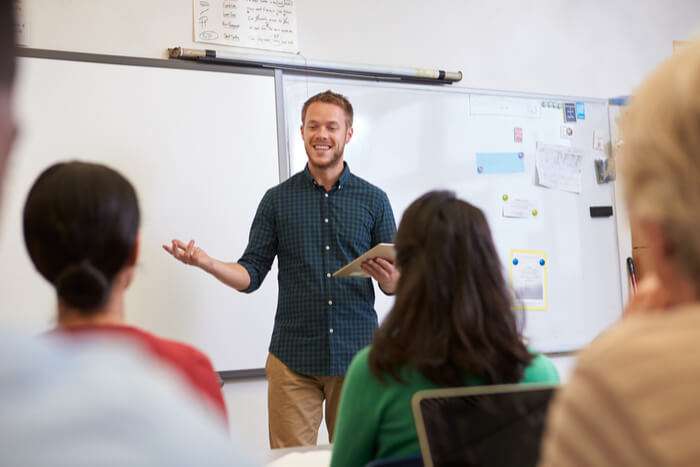 Teacher listening to students in class