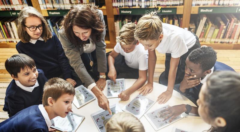 School Teacher Teaching Students Concepts
