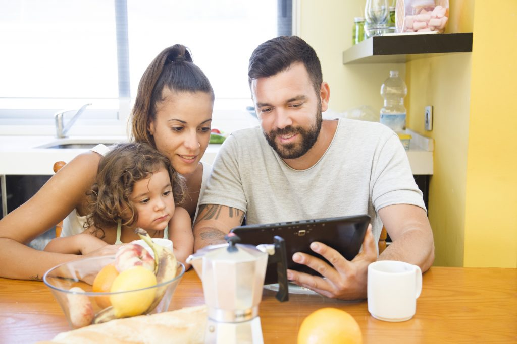 family looking digital tablet