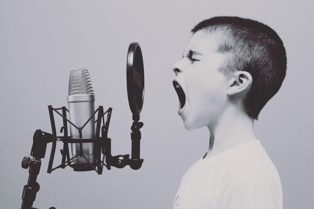 Boy yelling into mic
