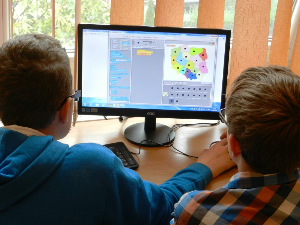 students on desktop computer