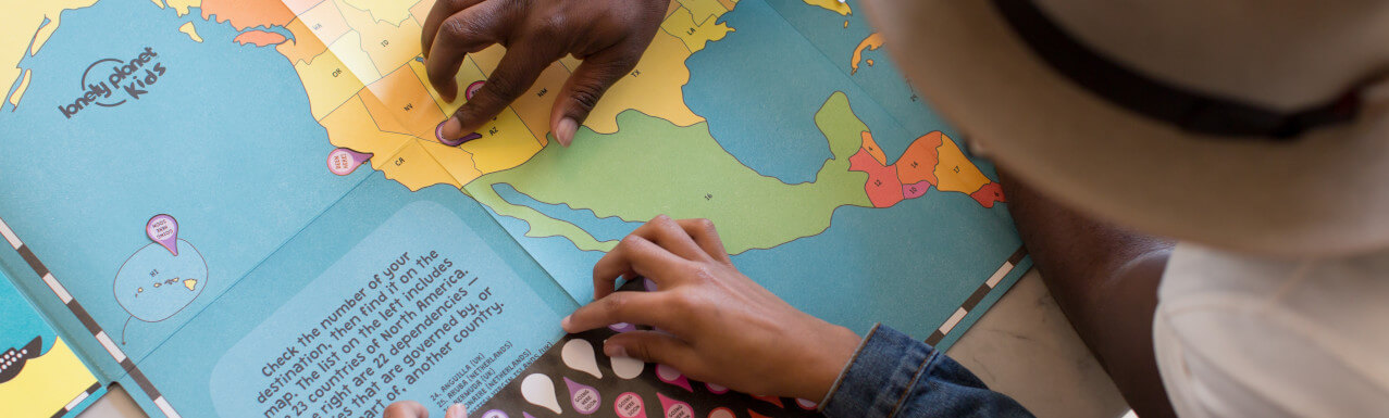 two students looking at a map of north america