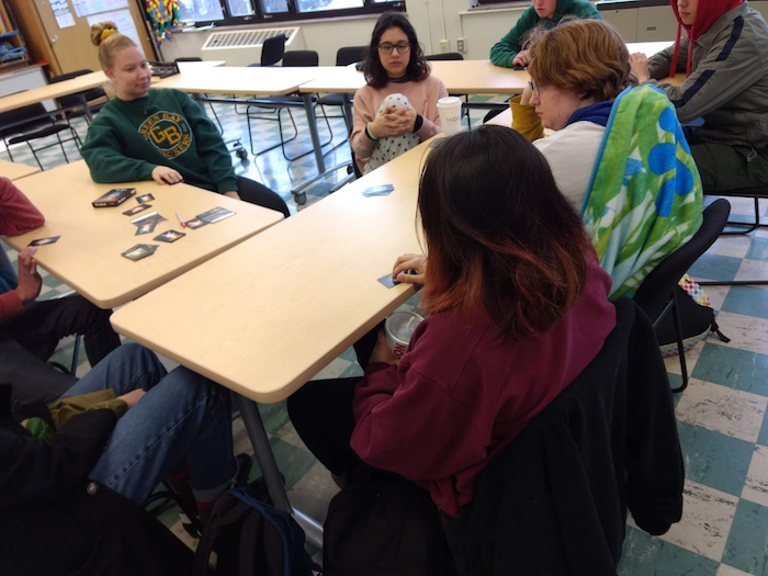 Students playing card game.