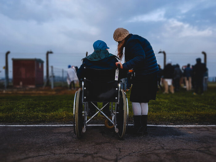 person in a wheelchair with someone next to her