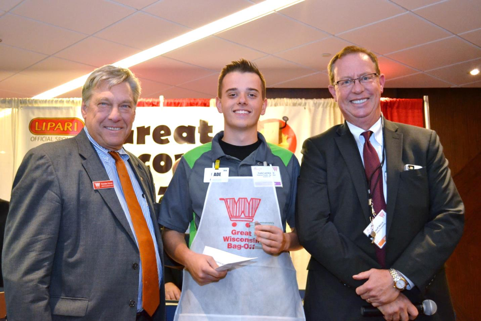 Cade, a bagger at Festival Foods, winning the Great Wisconsin Bag-Off.
