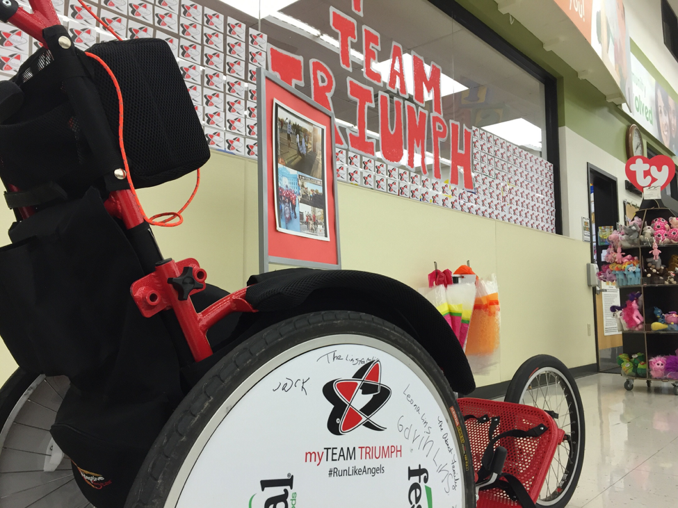 window with Team Triumph written on it and donations located by a wheelchair