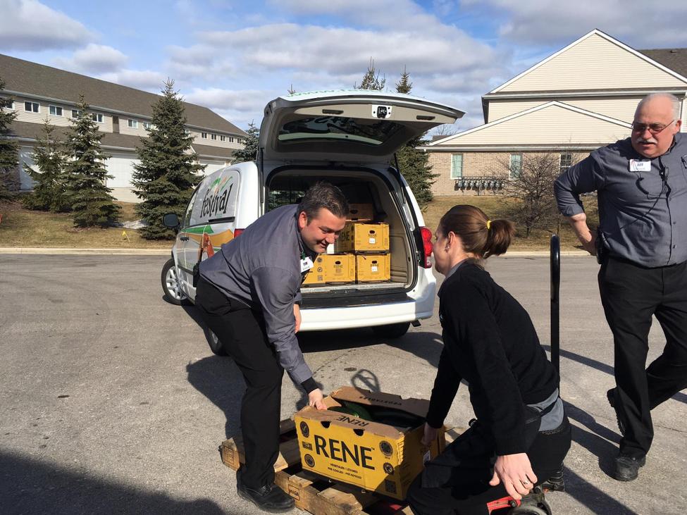 loading Festival Foods truck for Senior Fresh Produce Initiative