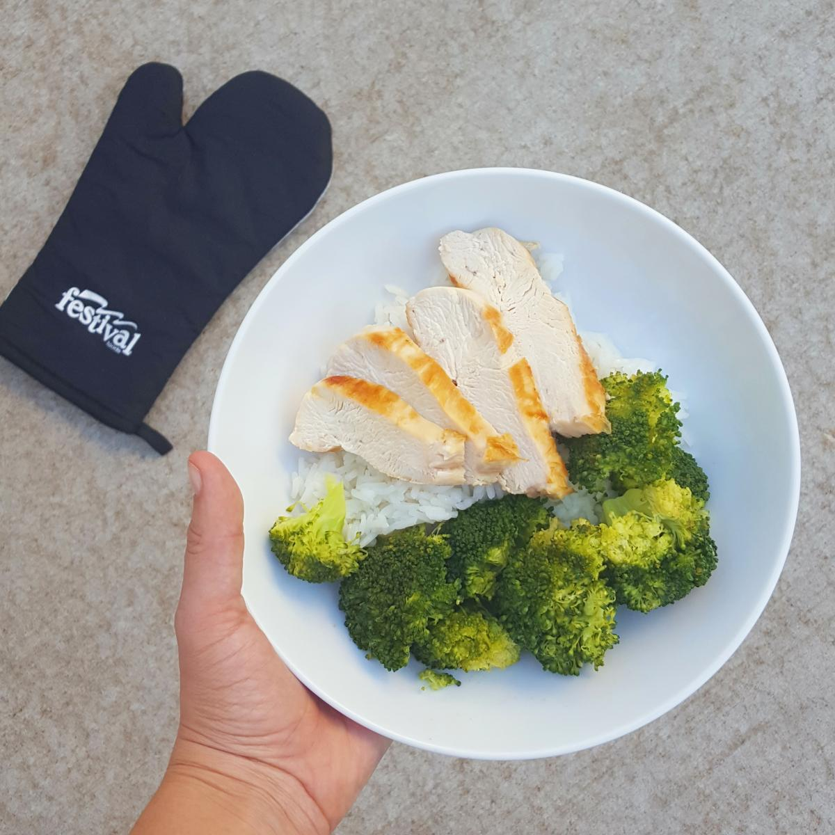 Plate of chicken and rice alongside oven mitt
