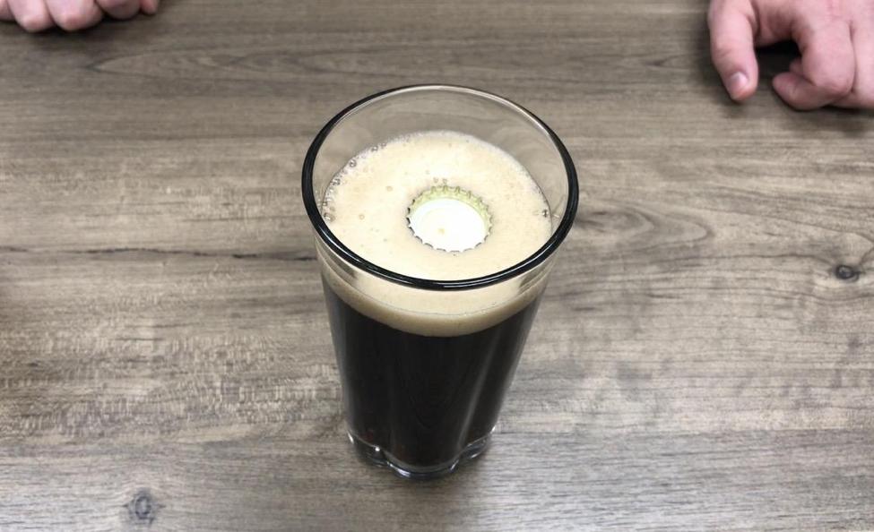bottle cap floating on a Guinness pint