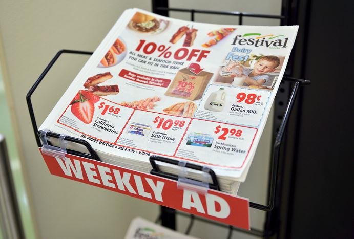 Weekly Ad on the stand