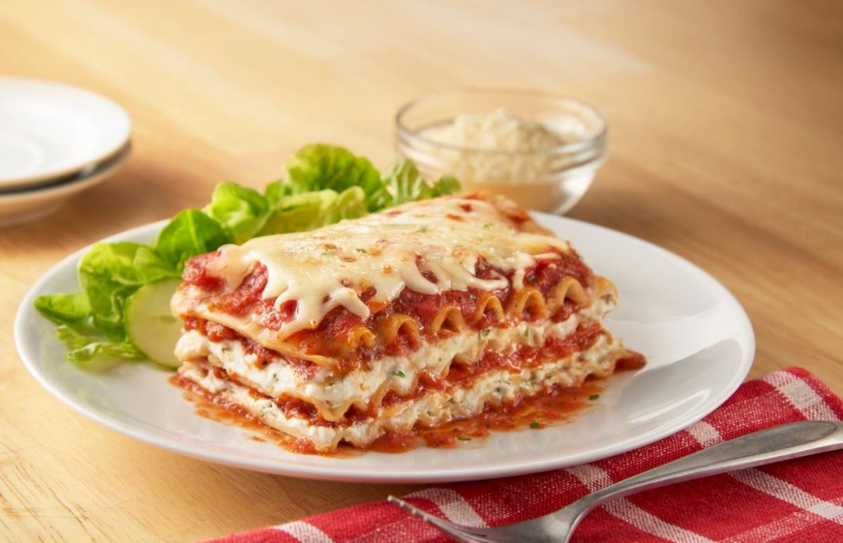 Slice of lasagna on a table
