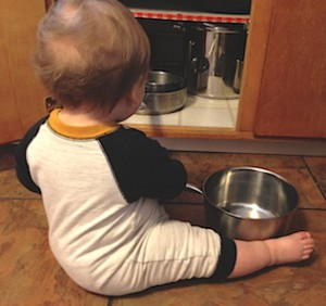 Baby playing while parent is cooking